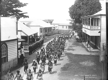 Samoan warriors and American servicemen during the Siege of Apia in March 1899.
